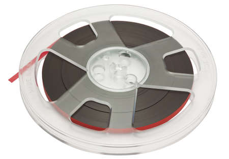 Open reel of quarter inch audio tape on spool isolated on white with clipping path Stock Photo
