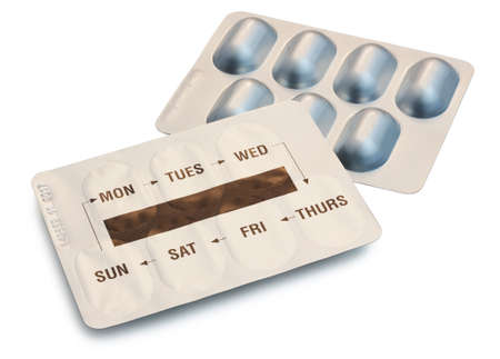 Two Blister Packets of Pills with days of the week printed on the pack isolated on white background with clipping path Stock Photo