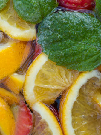 Closeup of Punch Cocktail with Fruit and Mint Leaves