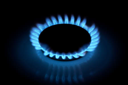 Gas hob cooker flame on black background