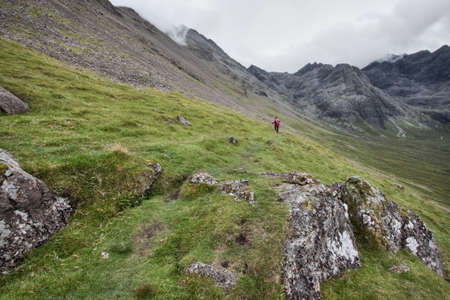 The Cuillin Landscape in Scotland with hiker