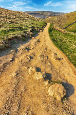 Rocky path through the Yorkshire Dales in England blue sky