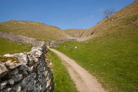Path and dry stone wall in The Yorkshire Dales in England 写真素材