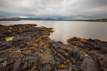 Landscape view across rocks and lake on Isle of Skye Scotland