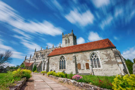 Wooton Wawen Church with moving clouds in a blue sky 写真素材