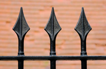 Black Iron fence with three spikes 写真素材
