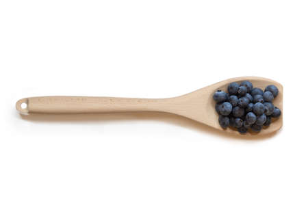 Handful of Blueberries on a Wooden Spoon from above