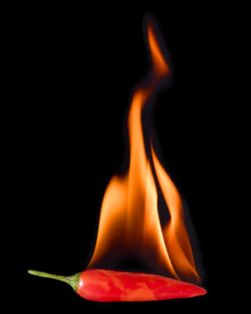 Red Hot Chili Pepper on Fire on black background 写真素材