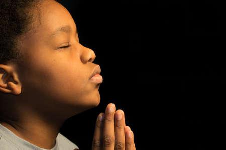少年は、神に祈る 写真素材