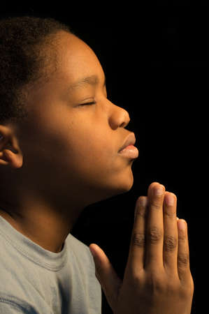 sanctification: A boy prays to God