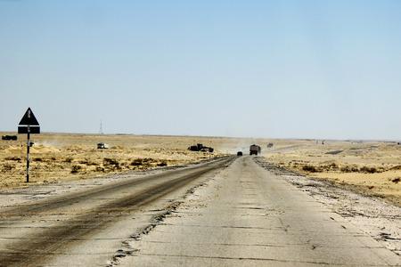concrete road through omani desert photo