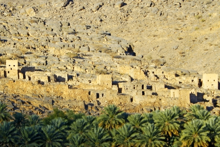 Ruins of old mudflat buildings in the city Biladt Sait in Oman photo