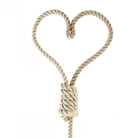fastening objects: a noose in the shape of heart isolated on white