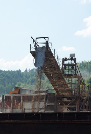 stone mining  on a river coast photo