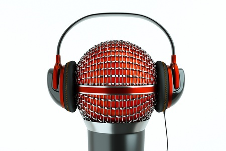 sound recording: a single microphone with headphones on white, a speak and listen concept Stock Photo