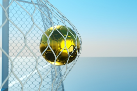 a goal concept, golden ball in a net