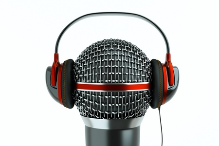 podcast: a single microphone with headphones on white, a speak and listen concept Stock Photo