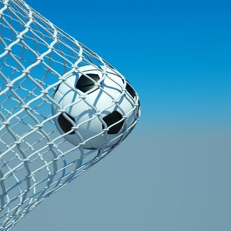 a soccer ball in a net, goal concept photo