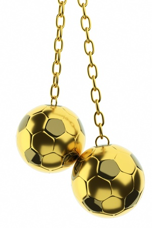 a golden soccer balls on a chain as a decoration stuff  photo