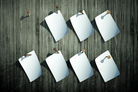 a blank white lists of paper on wooden wall  Stock Photo