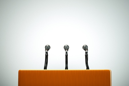a  podium with microphones photo