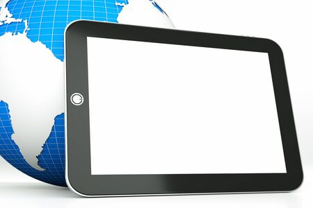 a tablet computer with globe as a concept of diagnosis of world economy state Stock Photo - 11819991