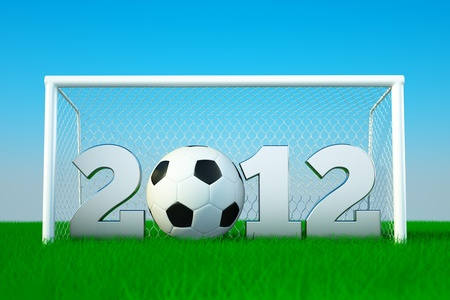 a 2012 soccer competition concept, ball with digiits on green grass photo