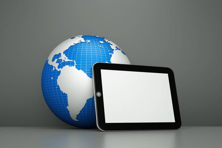 a tablet computer with globe as a concept of diagnosis of world economy state Stock Photo - 11886095
