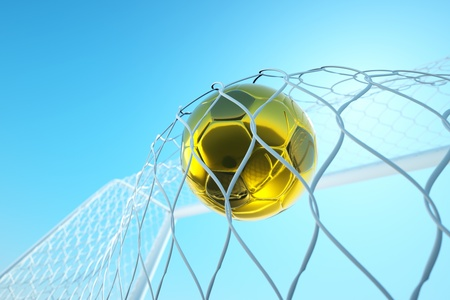 a goal concept, golden ball in a net photo