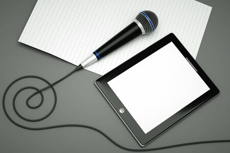 music book: a tablet pc with compass on grey Stock Photo