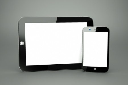 a tablet pc with modern cellphone on grey