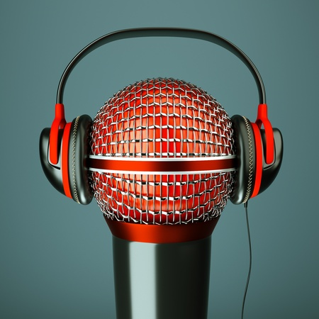 podcast: a single microphone with headphones on dark background, a speak and listen music concept Stock Photo