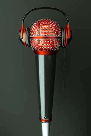 a single microphone with headphones on dark background, a speak and listen music concept photo