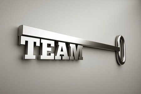a key with word team, business concept