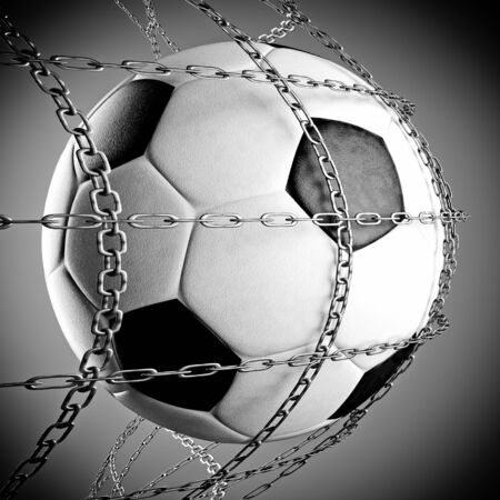 a soccer ball in a chain net, goal concept photo