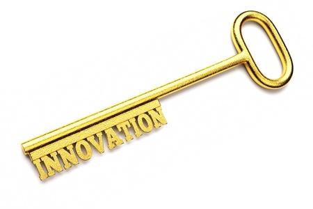 innovacion: de dos llaves de oro con palabras aisladas en blanco, concepto de negocio Foto de archivo