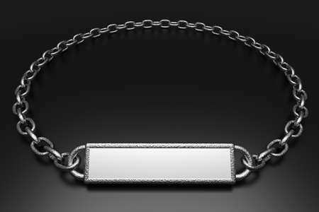 a silver pendant with blank place for word on black photo