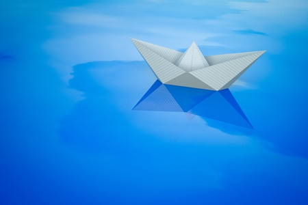 reflaction: a paper boat on water with sky reflaction
