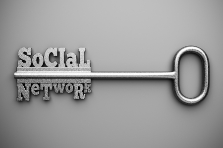 a silver key with words  social  anhd  network  as a concept