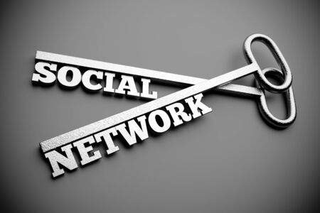 a two silver keys with words  social  anhd  network  as a concept photo