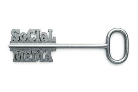 a silver key with words social media as a concept photo