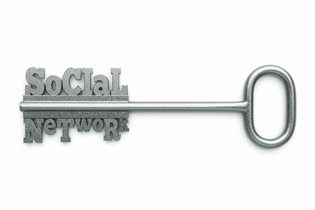 key to success: a silver key with words social network as a concept