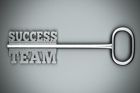 a key with words &quot,team&quot, and &quot,success&quot, business concept