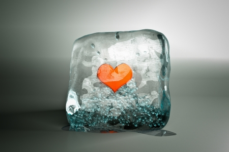 a frozen red heart as a symbol of frozen love, ice cube with heart photo