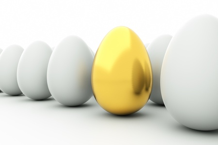 eggshells: a golden eggs on white Stock Photo