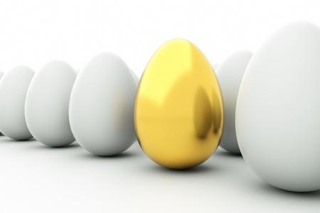 golden egg: a golden eggs on white Stock Photo