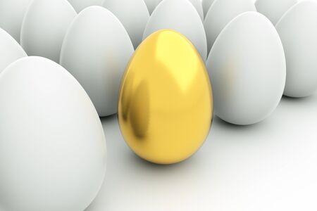 golden eggs: a golden eggs on white Stock Photo