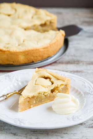 cream pie: Apple pie on plate as a background