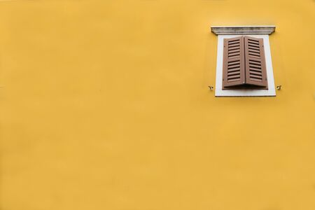 architech: vintage window on the yellow wall. Photo background for your design