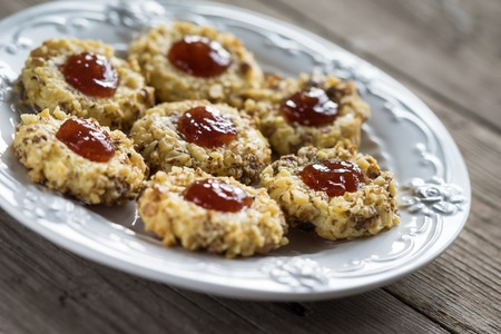 thumbprint: Cookies with walnuts and jam on a creative plate Stock Photo